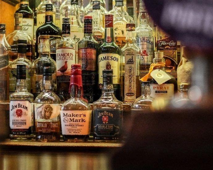 Bourbon Whiskey Behind a Barby Adam Wilson at Unsplash