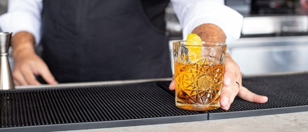 Old Fashioned bourbon cocktail by Andi Whiskey at Unsplash